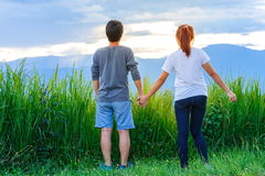 Couples, men and women ,Freedom traveler Couples standing with raised arms and enjoying Stock Photography
