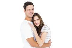 Couples mignons embrassant et regardant l'appareil-photo Photographie stock
