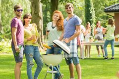 Couples minding the grill stock photo