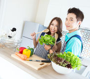 Couples in modern Kitchen stock images