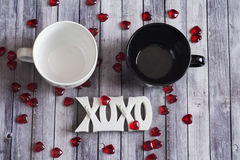 Couples mug on wood table Stock Images