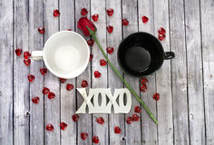 Couples mug on wood table with rose Stock Image