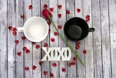 Couples mug on wood table with rose Stock Image