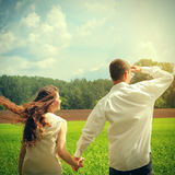 Couples outdoor. Toned photo of Happy Young Man and Teenage Girl at the Summer Field Royalty Free Stock Photo