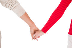 Couples partageant la vue arrière de mains Photographie stock libre de droits