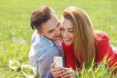 Couples with phone taking self portrait Royalty Free Stock Photo