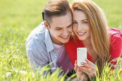 Couples with phone taking self portrait Royalty Free Stock Images