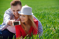 Couples with phone taking selfie self portrait Royalty Free Stock Images