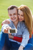 Couples with phone taking selfie self portrait Stock Images