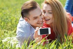 Couples with phone taking selfie self portrait Royalty Free Stock Photo