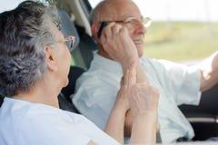 Couples pluss âgé dans la voiture Photographie stock libre de droits