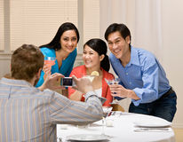 Couples posing for photograph at dinner party Stock Photography