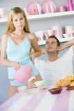Couples prenant le petit déjeuner Photos stock