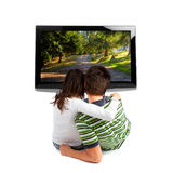 Couples regardant la TV Photo libre de droits