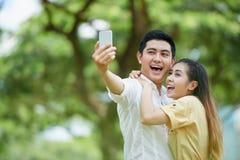 Couples riants Photo libre de droits