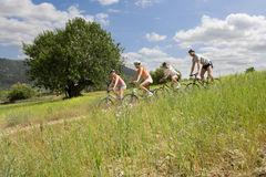 Couples riding bicycles on rural path royalty free stock photo