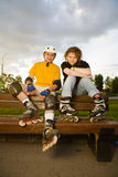 Couples rollerblading image stock