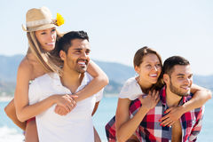 Couples on romantic summer holidays. Portrait of young attractive couples in love on romantic summer holidays vacation stock photography