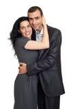 Couples romantiques dans l'amour, la belle femme heureuse et l'homme bel d'isolement sur le fond blanc Photo stock
