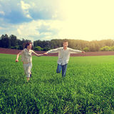 Couples running at the Field Royalty Free Stock Image