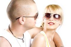 Couples s'embrassant par espièglerie Photographie stock libre de droits
