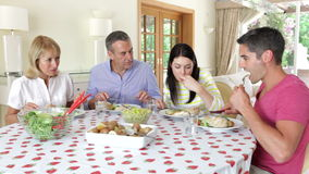 Couples seated around dining table  stock video