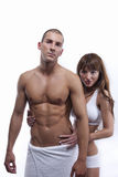 Couples sexy de muscle d'isolement sur le blanc Image stock