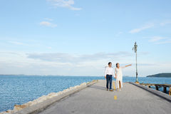 Couples showing love and happy to travel anywhere. Royalty Free Stock Photo