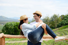 Couples showing love and happy to travel anywhere. Stock Image