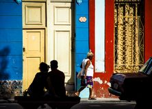 Silhouette of a couple in Havana. A couples silhouette in front of an colourful house in havana Royalty Free Stock Photo