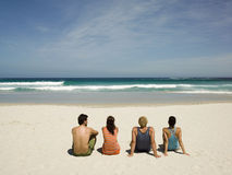 Couples sitting on the beach Royalty Free Stock Photography