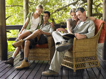 Couples Sitting In Wicker Chairs On Terrace Stock Photography