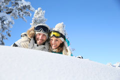 Couples of skiers lying in the snow Royalty Free Stock Image