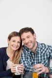 Couples souriant en petit déjeuner Images stock