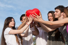 Couples with a sphere in the form of heart Royalty Free Stock Image