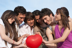 Couples with a sphere in the form of heart Stock Photos
