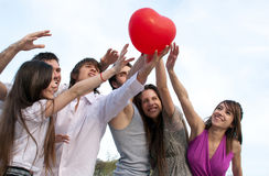 Couples with a sphere in the form of heart Stock Images