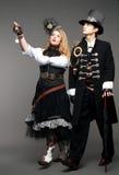 Couples stylisés de vapeur-punk de cru photo stock