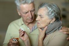 Couples supérieurs malades Photographie stock