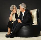 Couples supérieurs sur le fond noir Photographie stock libre de droits