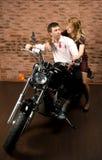 Couples sur la motocyclette Photos libres de droits