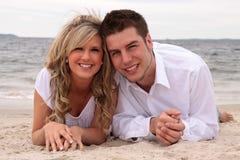 Couples sur la plage Photographie stock