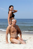 Couples sur la plage Photos libres de droits