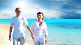 Couples sur la plage Images libres de droits