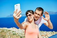 Couples sur la plage de mer Photographie stock