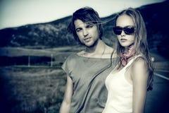 Couples sur la route Photographie stock libre de droits