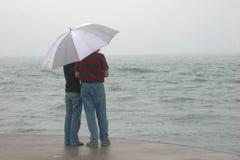 Couples sur le pilier Photographie stock libre de droits