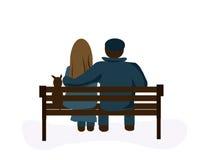 Couples sur un banc de stationnement Photo stock