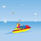 Couples sur un ski d'avion à réaction Vacances d'été Sports d'eau Image libre de droits