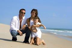 Couples sur une plage Photo stock
